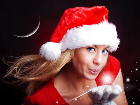 young christmas woman holding star over dark background photo