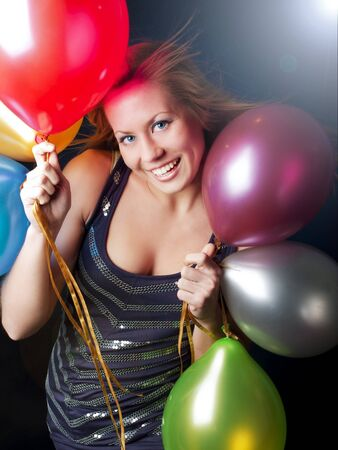 smiling young woman on party holding ballons photo