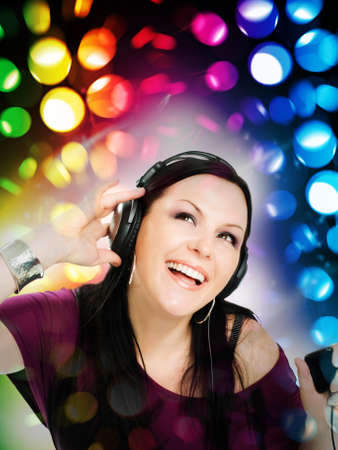 smiling young woman with headphones listening music by mp3  Stock Photo - 8273345