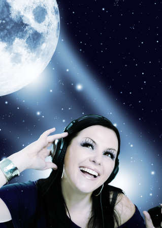 smiling young woman listening music in the moon light
