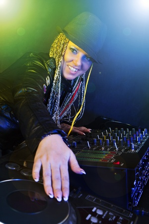 smiling dj woman playing music by mixer Stock Photo - 8371044