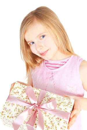 smiling girl holding present over white background photo