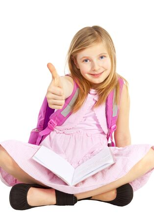 smiling girl with backpack pointing ok sign over white background photo