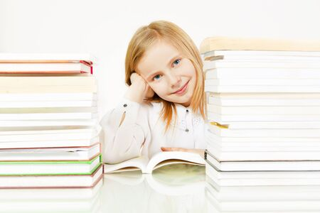 small smiling girl reading book in library Stock Photo - 9206288