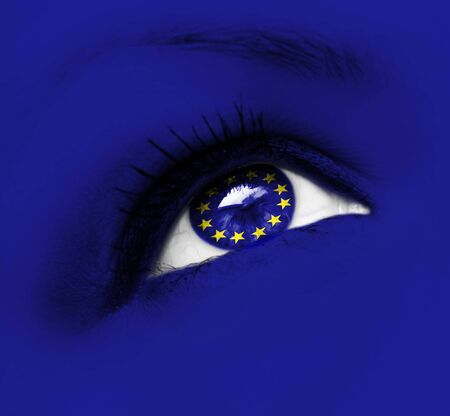 closeup of blue eye with european union flag photo