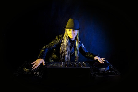 smiling dj woman playing music by mikser photo