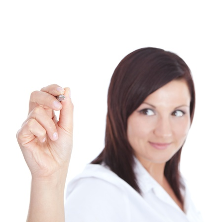 Young beautiful businesswoman with pen writing on the screen. Focus on pen photo