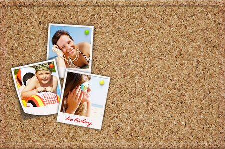 cork board with holiday photos of happy joying people photo