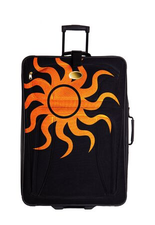 dark suitcase with sun drawing isolated over white background photo