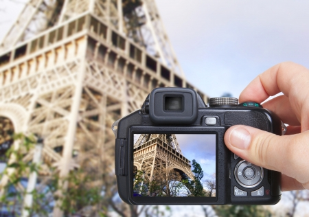 camera lens: hand making shot of eiffel tower by camera