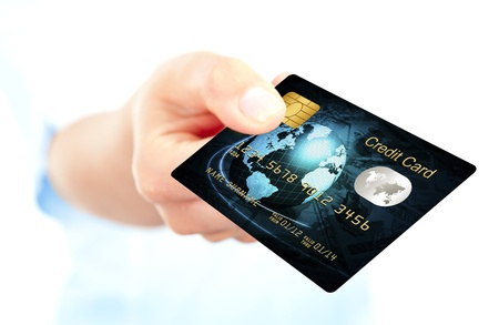 trade credit: closeup of blue credit card holded by hand. focus on card Stock Photo