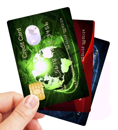 credit cards fan holded by hand over white background Stock Photo - 15182475