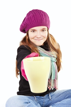 teenager weared spring clothes, holding cup of warm tea  photo