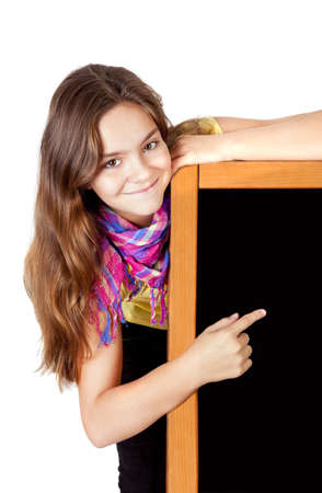 smiling girl pointing blackboard isolated over white background photo