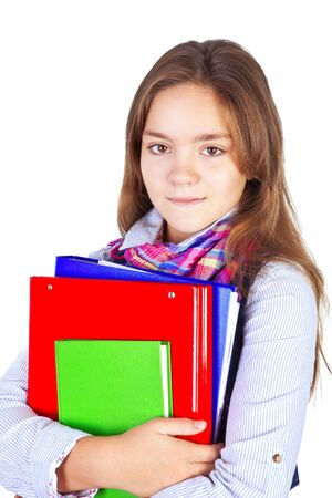 smiling teenager with backpack and books isolated over white background photo