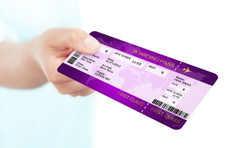 violet fly boarding pass ticket holded by hand over white background photo