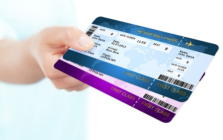 two boarding pass tickets holded by hand over white background