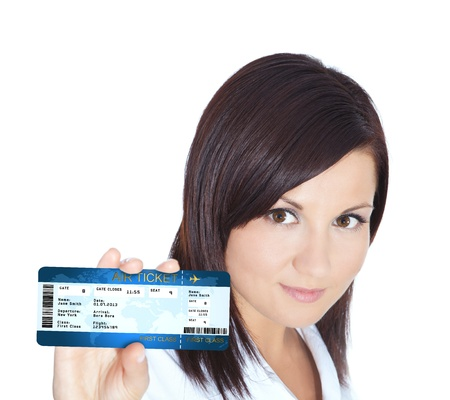 smiling beautiful woman holding air ticket isolated over white background photo