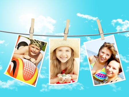 photos of holiday people hanging on clothesline by clothespins with sky background