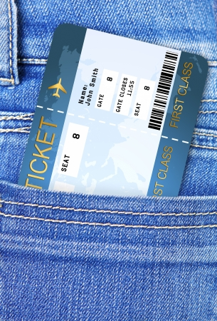closeup of air ticket in trousers pocket photo
