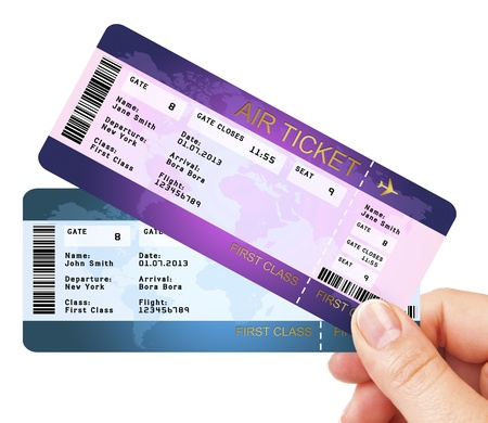 fly air tickets holded by hand over white background photo
