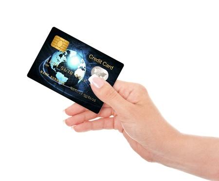 白い背景の上の手で折り畳み青いクレジット カードのクローズ アップ