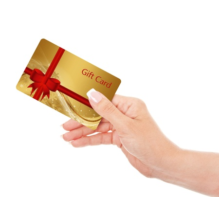 show cards: hand holding gift card isolated over white background Stock Photo