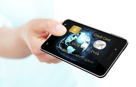 hand holding mobile phone with credit card screen isolated over white background photo