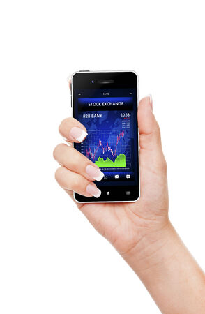hand holding mobile phone with stock market chart isolated over white photo