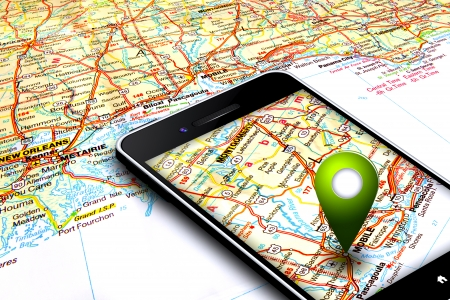 gps map: mobile phone with gps laying on map