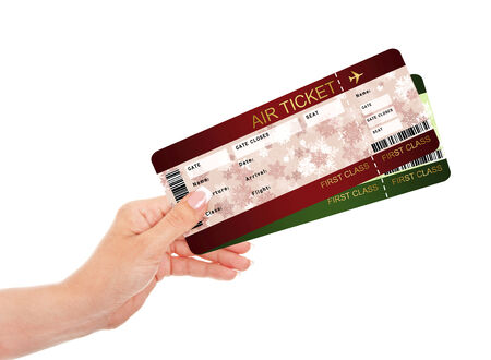 hand holding christmas fly air tickets over white