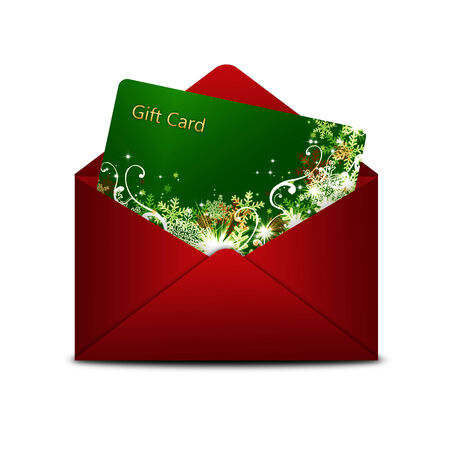 christmas gift card in red envelope isolated over white  photo
