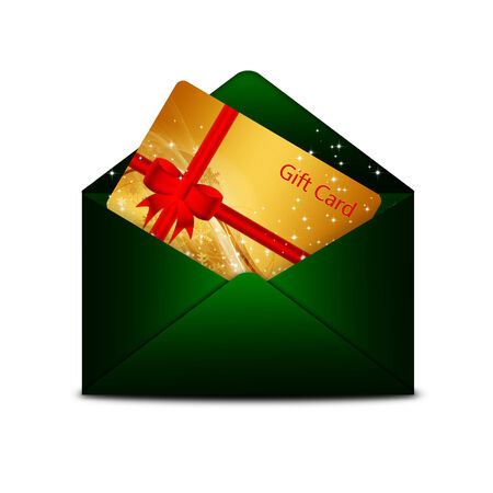 christmas gift card in green envelope isolated over white  photo