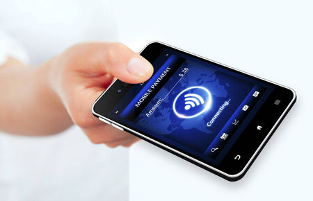 hand holding phone with mobile payment connection over white background photo