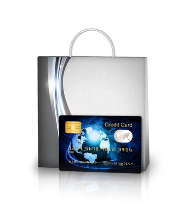 shopping bag and credit card isolated over white  photo