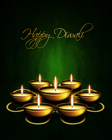 oil lamp with diwali greetings over dark green background photo