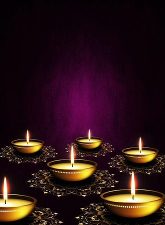 oil lamps with place for diwali greetings over dark violet background photo