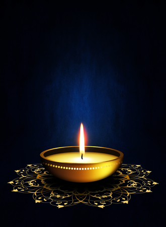 oil lamp with place for diwali greetings over dark blue background photo