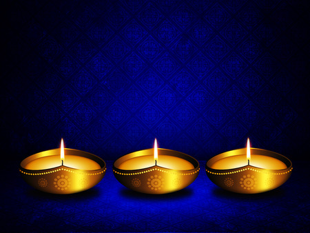 oil lamp with place for diwali greetings over dark blue  photo