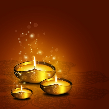 oil lamp with place for diwali greetings over gold  写真素材