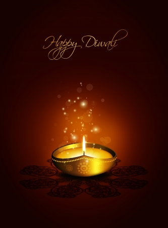 oil lamp with place for diwali greetings over gold  photo