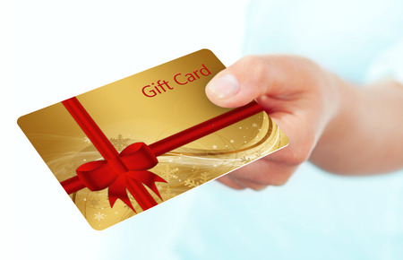 hand holding gift card isolated over white background Фото со стока