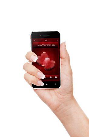 hand holding mobile phone with valentine's day wishes isolated over white  photo