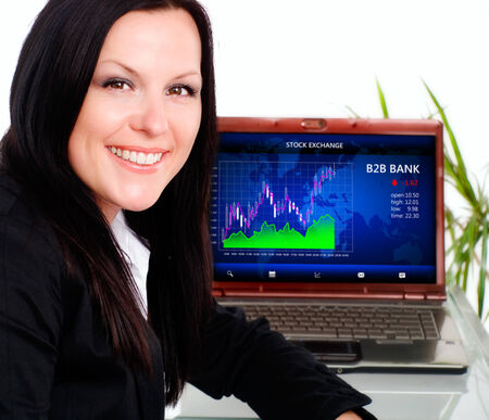 smiling brunette businesswoman in office with laptop photo