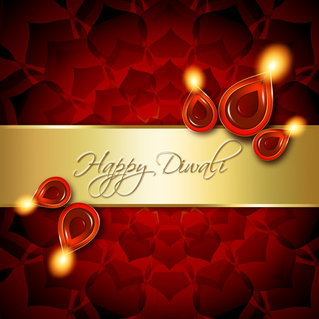 oil lamps with diwali greetings over dark red background photo