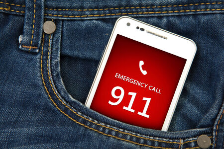 emergency number: mobile phone in pocket with emergency number 911. focus on screen