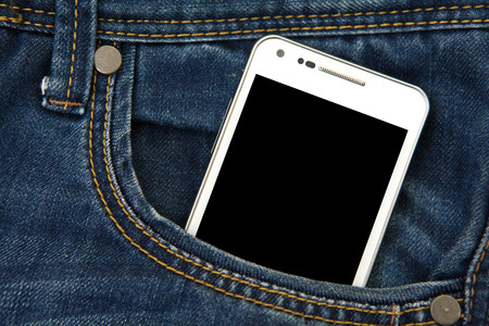 mobile phone in pocket with black screen. focus on screen.
