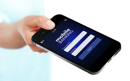 mobile phone with mobile banking log in page holded by hand isolated over white background Фото со стока