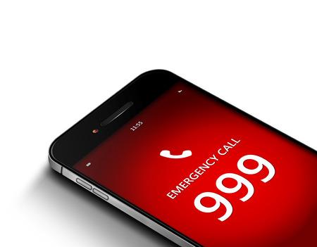 白い背景の上の緊急番号 999 と携帯電話
