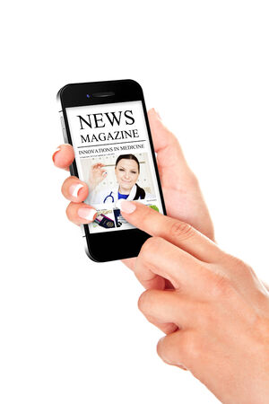 hand holding mobile phone with news magazine isolated over white background photo